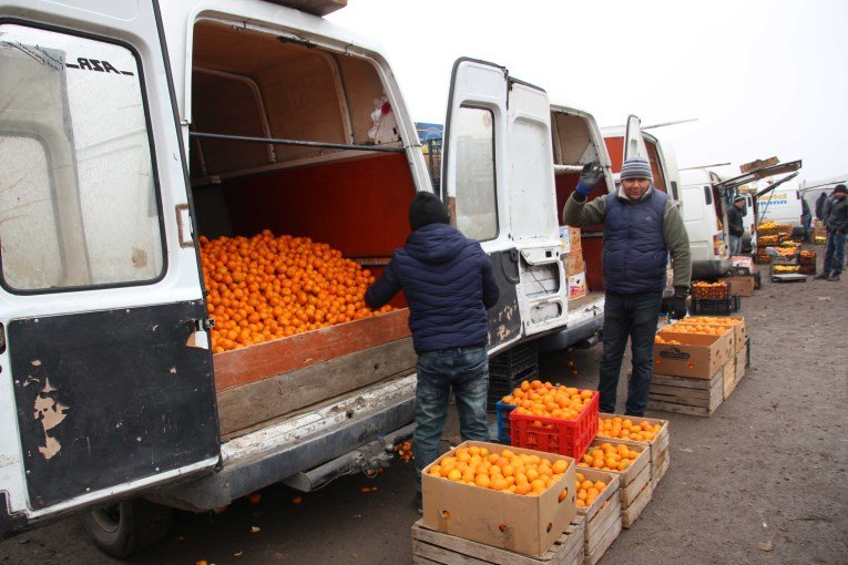 Right after the border of Georgia and Armenia our driver bought loads of mandarin fruit